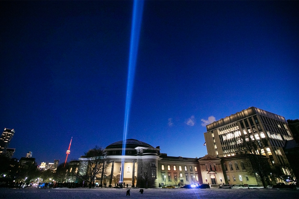 A large spotlight is lit in front of convocation hall to remember the victims of the Montreal massacre on the 30th anniversary