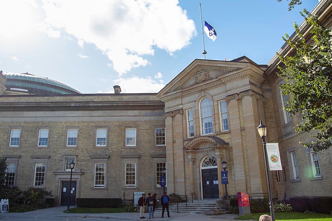Simcoe Hall with the University flag at half-mast