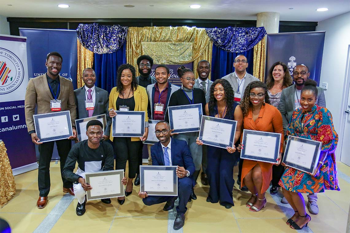Group photo of the African Scholar awards winners holding up their awards
