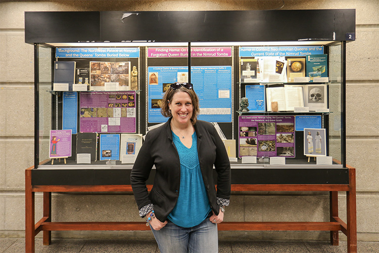 Tracy Spurrier in front a display of her research