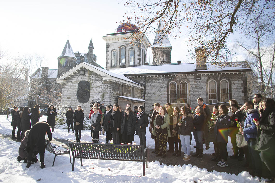 a view of the crowd gathered on the national day of remembrance outside hart house