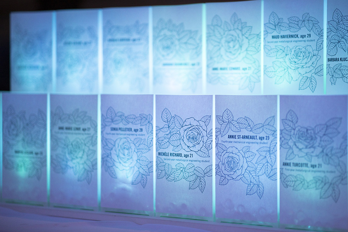 The names of the murdered women on cards illuminated by blue light on the national day of remembrance 2019