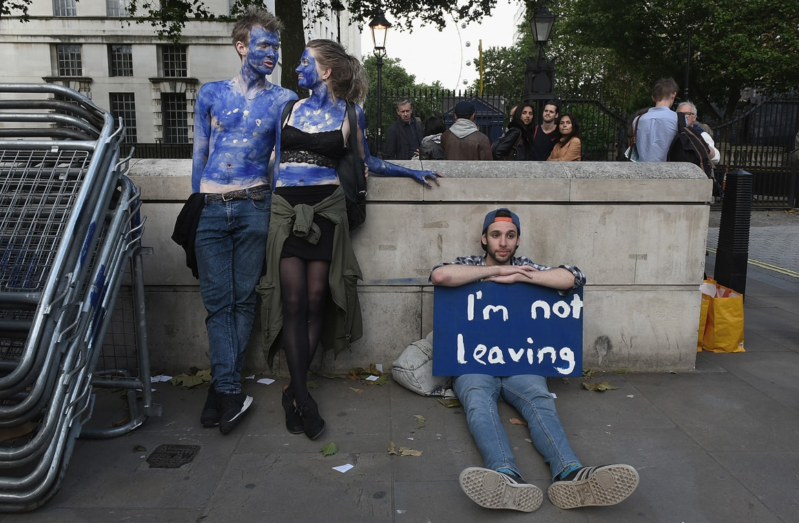 A young couple painted as EU flags protest on outside Downing Street against the United Kingdom's decision to leave the EU following the referendum on June 24, 2016 in London, United Kingdom.