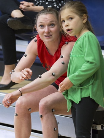 photo of Rosie MacLennan with young fan