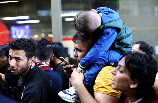 photo of Syrian refugees at Vienna train station