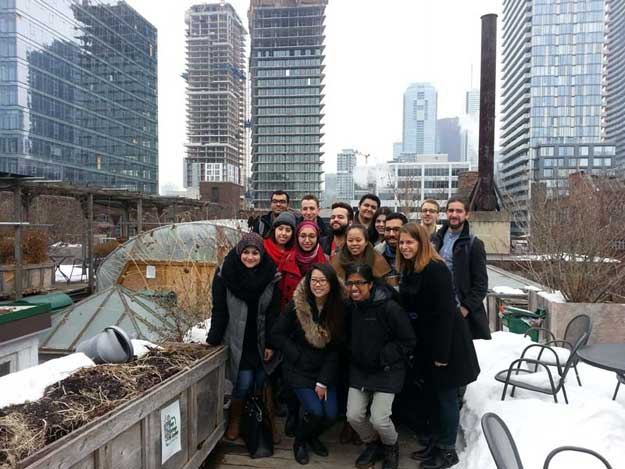photo of Shauna Brail with students on roof of 401 Richmond