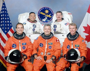 photo of Marc Garneau and other astronauts