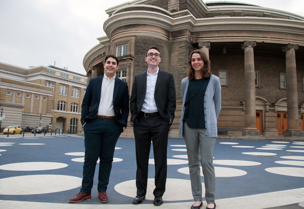 photo of the three Rhodes scholars in front of Convocation Hall