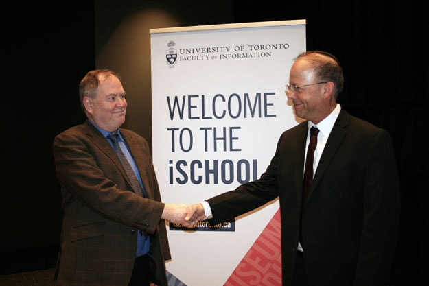 photo of Dean Seamus Ross shaking hands with Gertner
