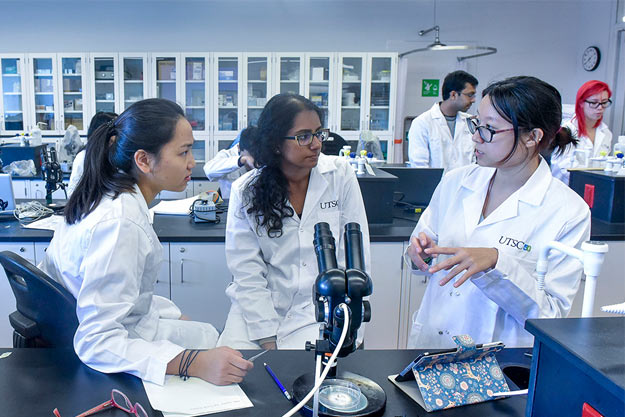 Photo of chemistry students working together in a laboratory
