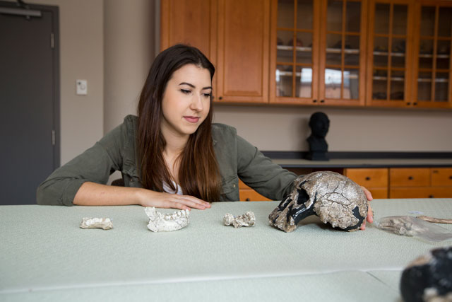 photo of Klara Komza with fossils
