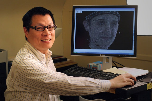 photo of Kang Lee at computer