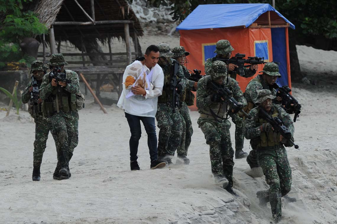 Philippine soldiers carry out a mock hostage rescue exercise