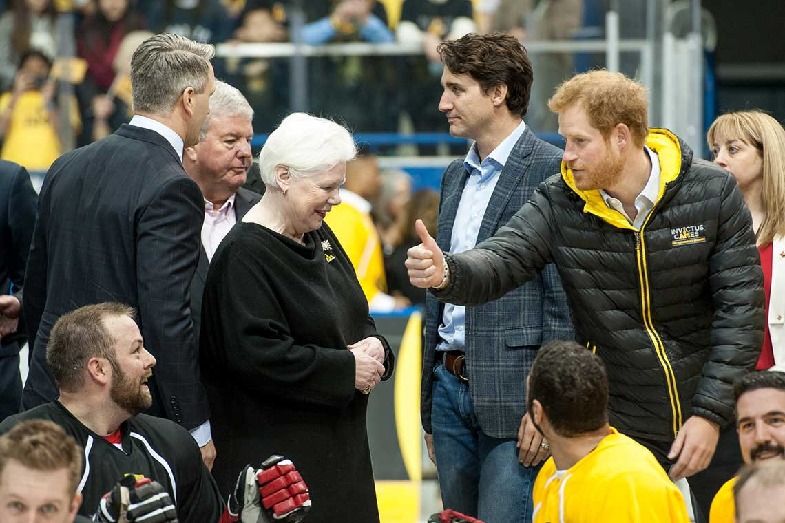 photo of Prince Harry with Prime Minister Trudeau and others at sledge hockey game