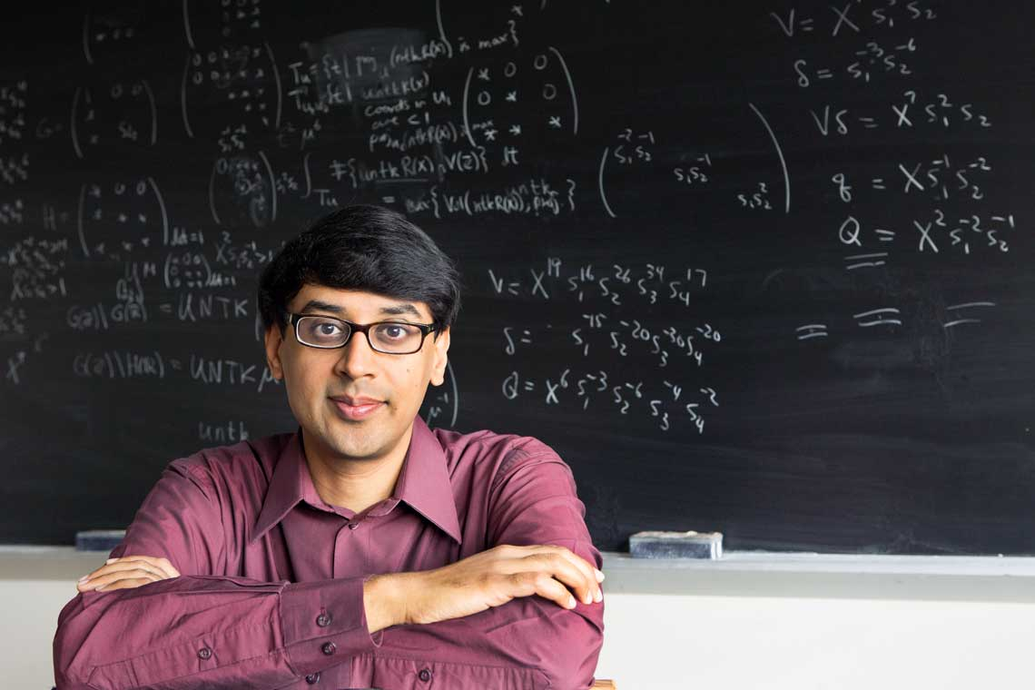 photo of Bhargava in front of blackboard