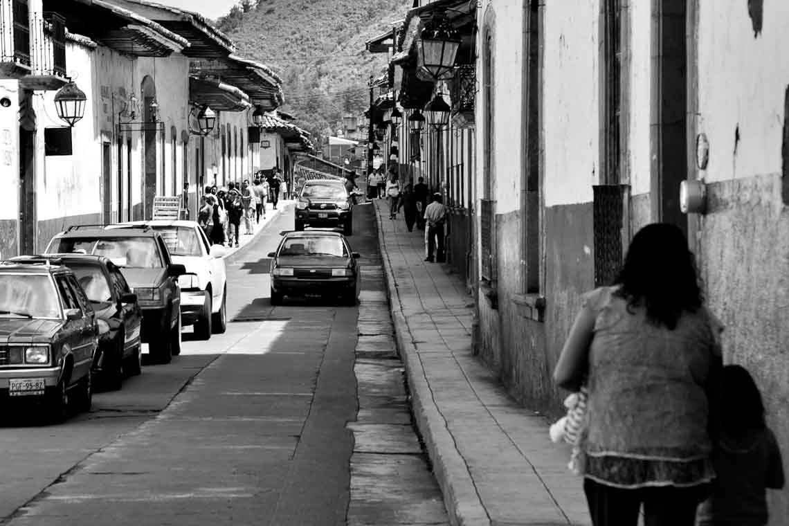 black and white photo of a paved road in Mexico