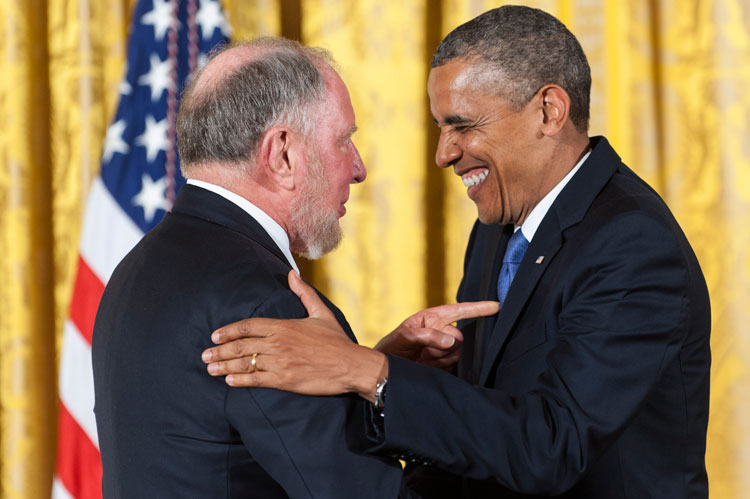photo of U.S.  President Obama presenting Putnam with a medal