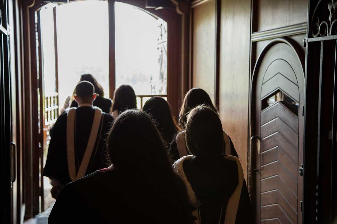 photo of grads exiting university college doors