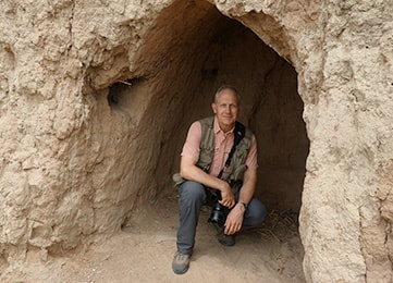 photo of Crawford in a cave