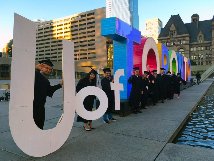 photo of grads with Toronto sign