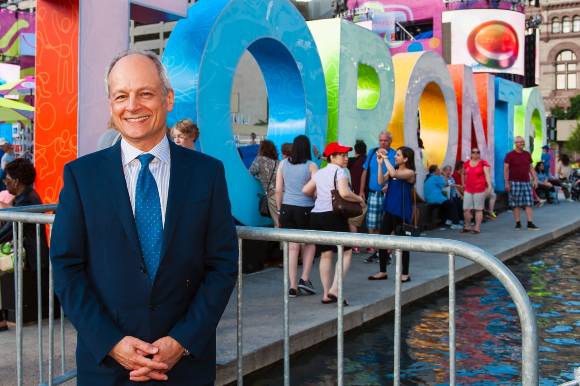 photo of Meric Gertler in front of Toronto sign