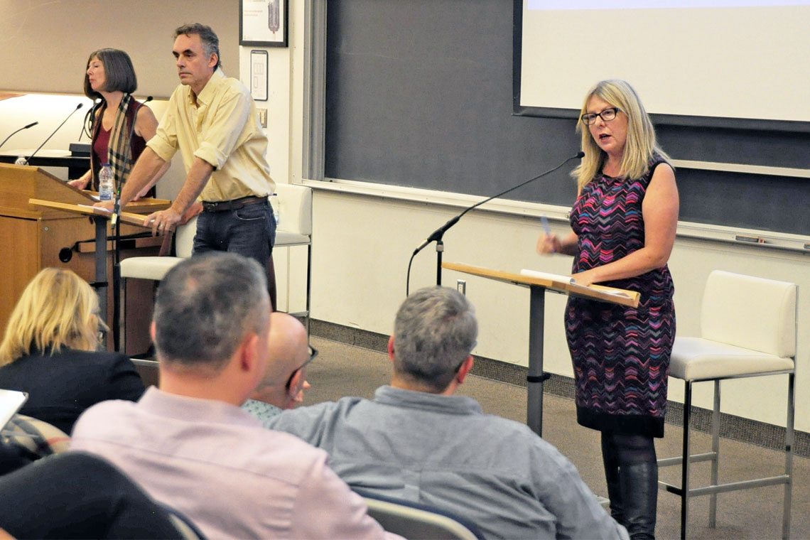 photo of Moran, Peterson and Cossman at forum