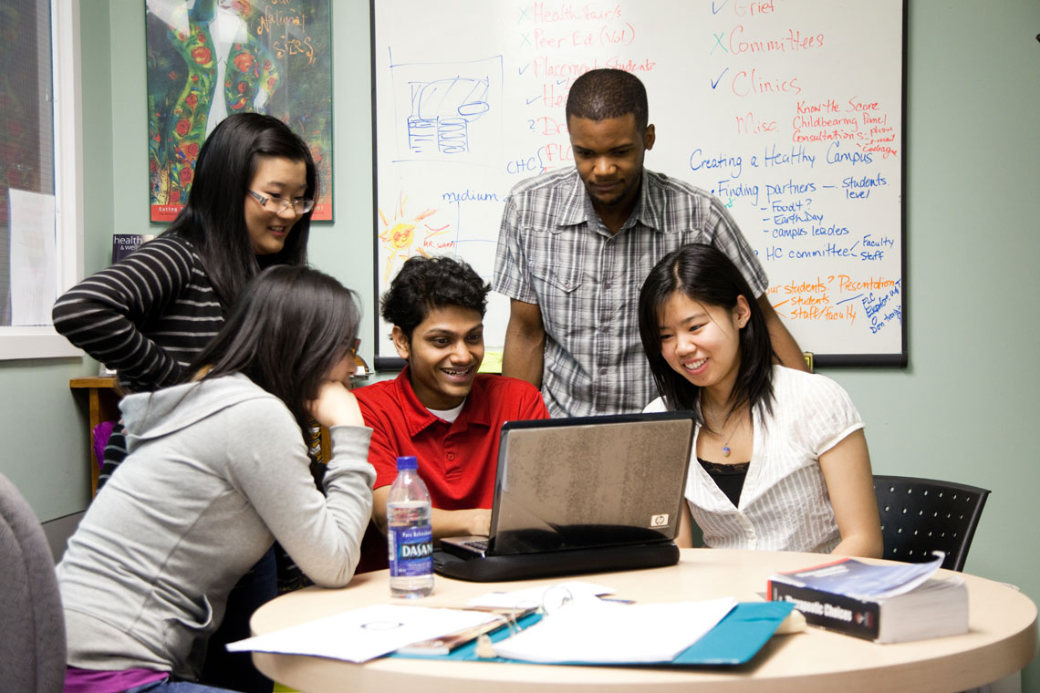 photo of students around a table
