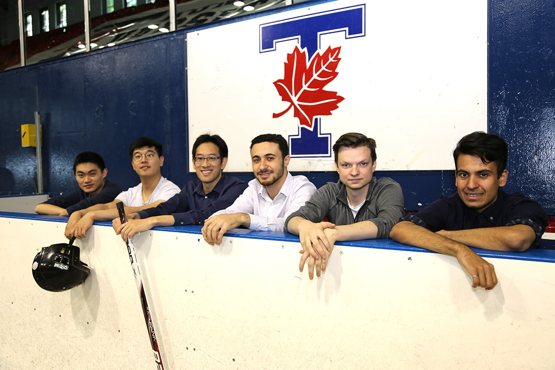 photo of Timothy Chan and students
