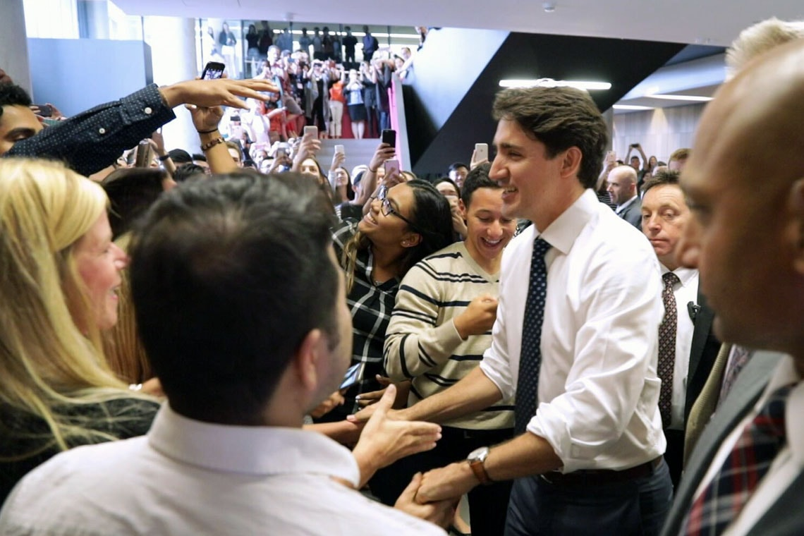 photo of Trudeau greeting crowd of students