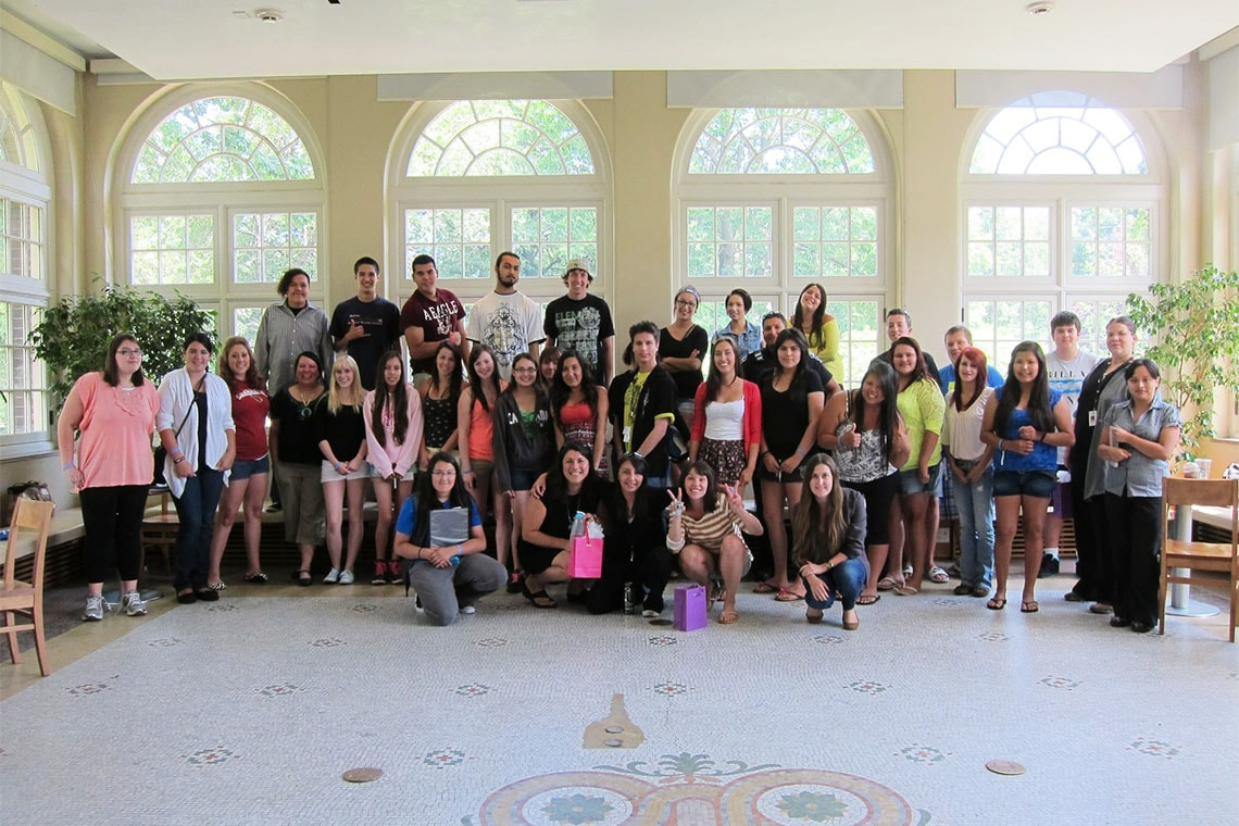 IYSP participants pose for a group photo with Amanda Carling