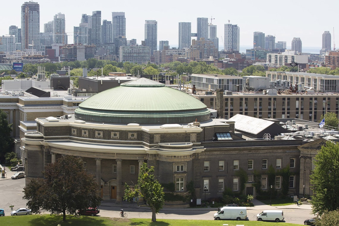 Photo of U of T against background of Toronto skyline