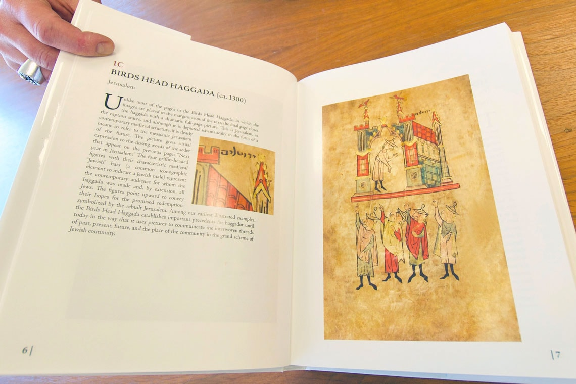 photo of Cohen's book, held open to show illustration of illuminated manuscript