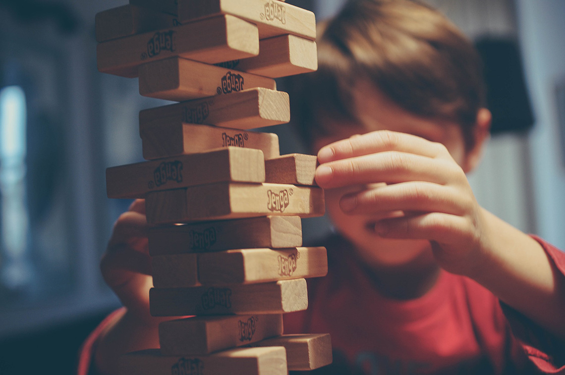 Photo of child playing Jenga