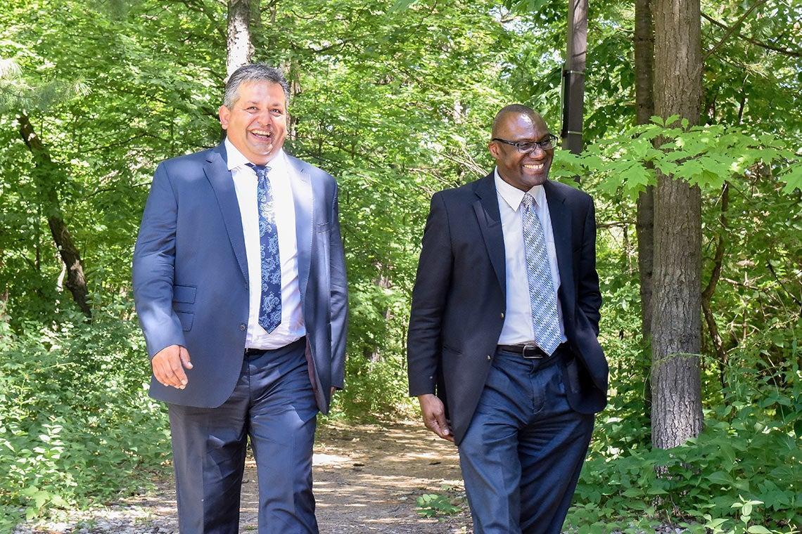 photo of Wisdom Tettey and Andrew Arifuzzaman walking on campus