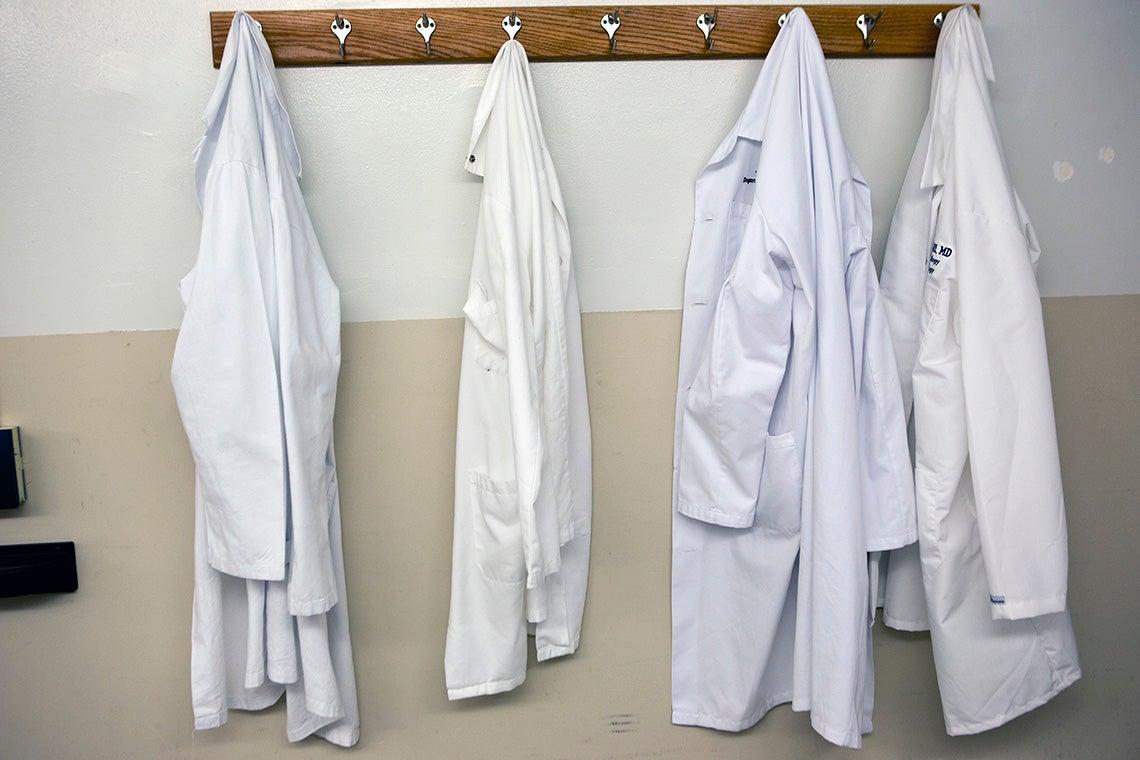 Photo of hanging doctors' coats
