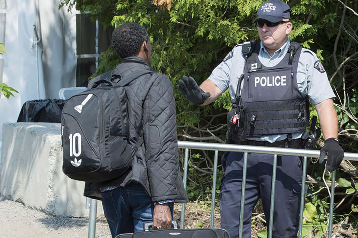 Photo of asylum-seeker entering Canada