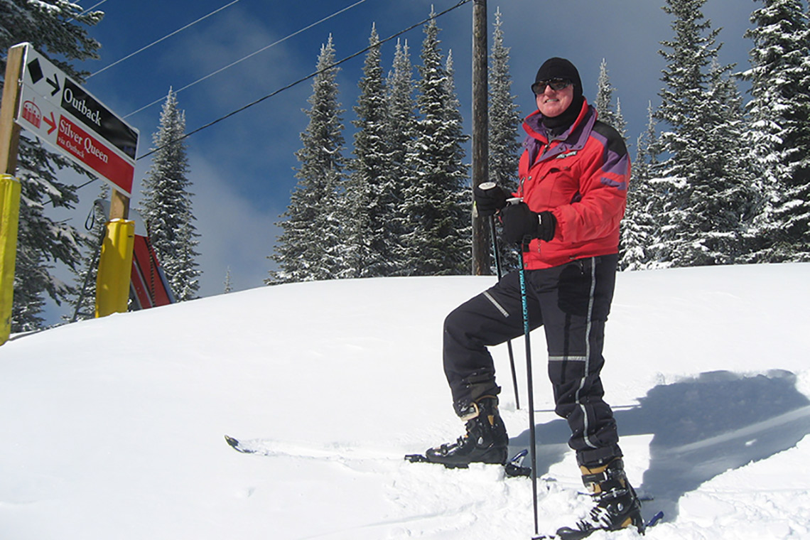 Photo of graduate John Horton on a ski hill