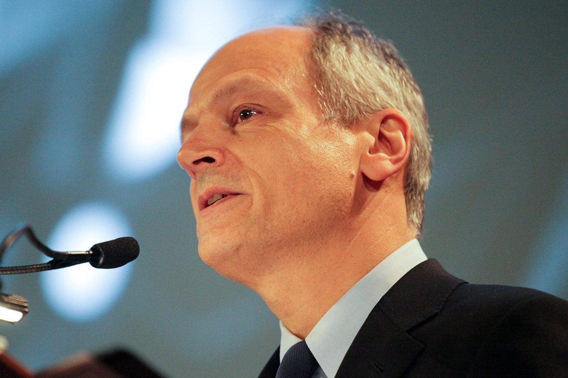 Meric Gertler speaking at a podium