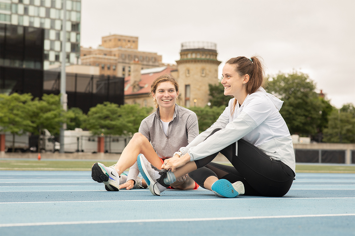 Madeleine Kelly (left), a U of T alumna and fellow Varsity Blues runner, trained for the Olympics with Lucia Stafford, forging a close bond in the process (Photo: Johnny Guatto)