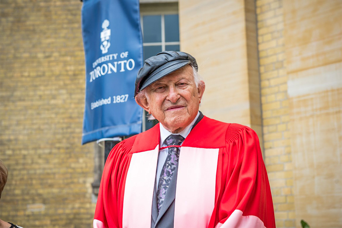 Nathan Liepciger stands outside Simcoe Hall before receiving his honorary degree