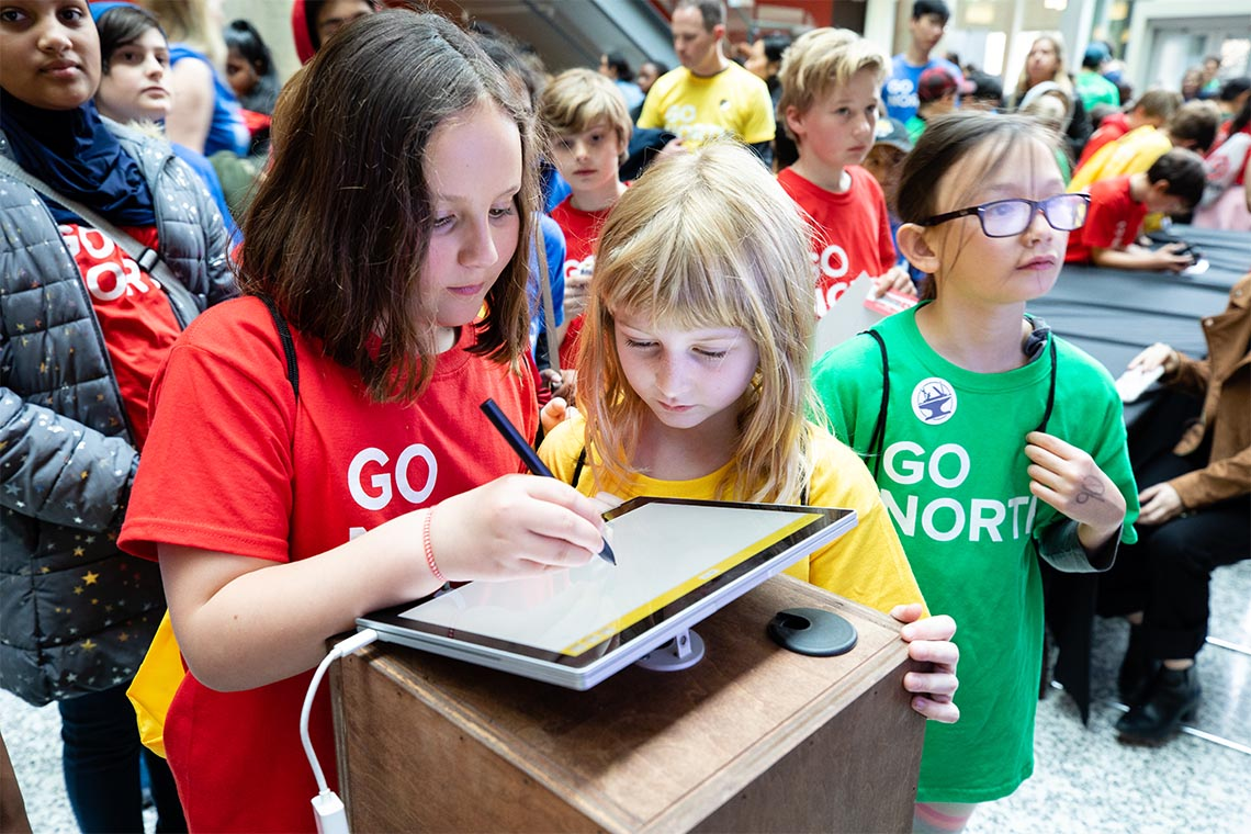 photo of children using a tablet