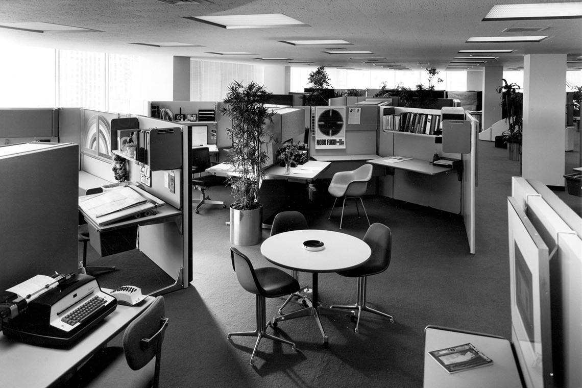 Photo of a mid-century open-concept office space