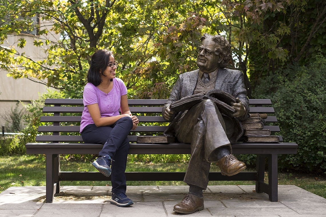 Apala Das and Northrop Frye statue
