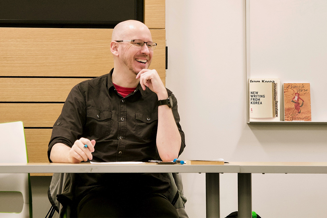 Nathan Sanders has a laugh while teaching his class
