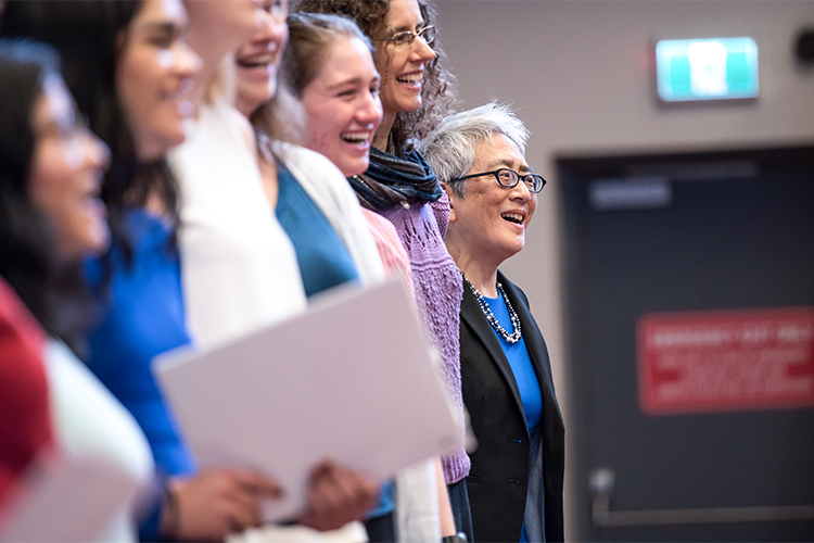 Carol Chan sings with the choir during her installation ceremony at Woodsworth College
