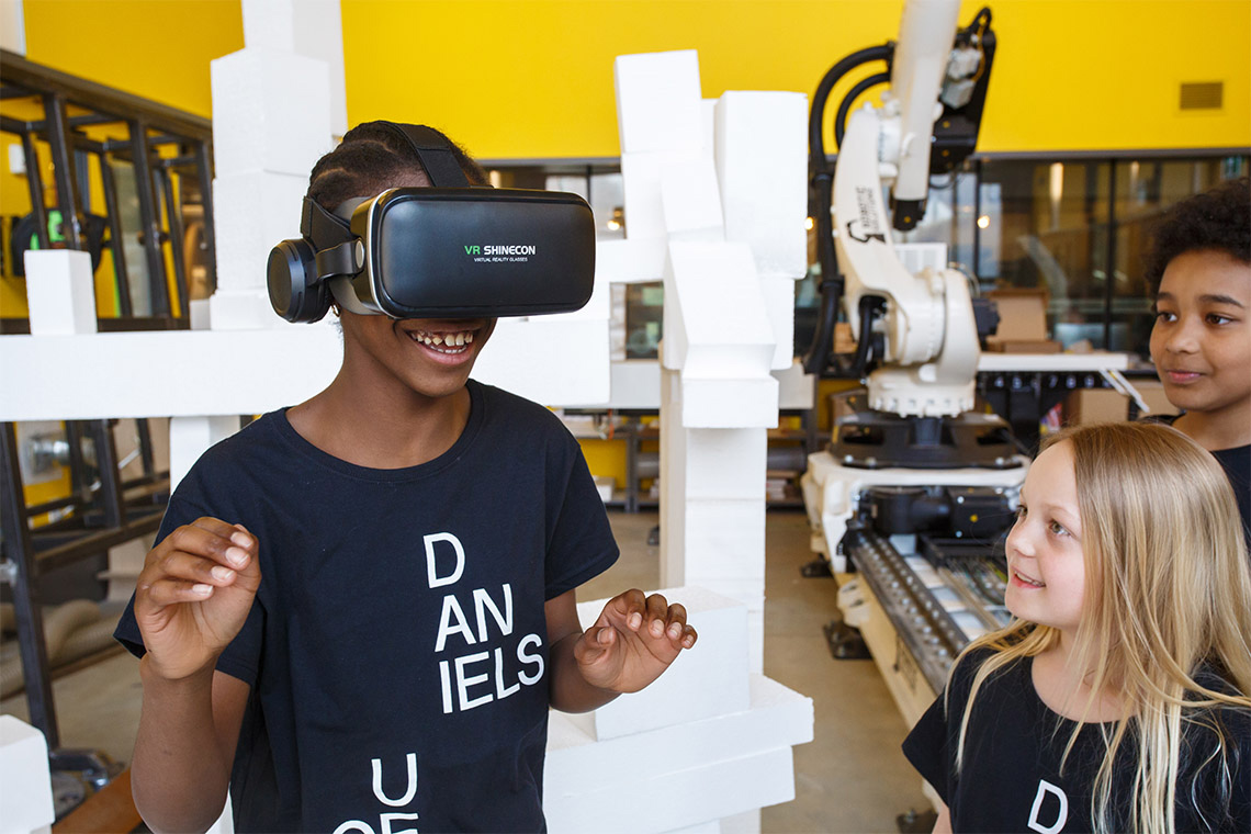 Photo of student wearing a VR headset