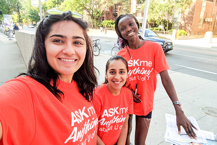 students wearing ask me anything shirts