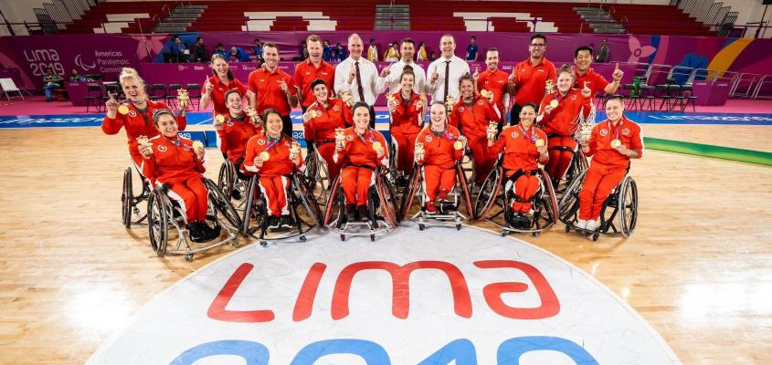 Erica Gavel poses with her teammates after qualifying for 2020 Tokyo Paralympic Games