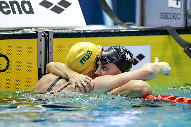 Kylie Massea is congratulated after winning the gold medal by silver medalist Emily Seebohm