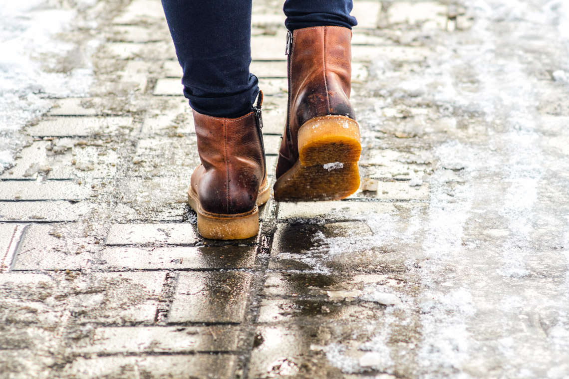Man walking on icy sidewalk